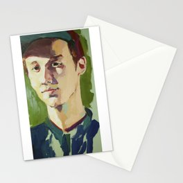 Young Kenneth Surrounded by Green Stationery Cards