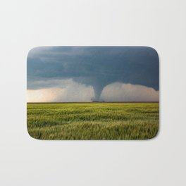Behind the Scene - Large Tornado Passes Safely Behind a Farmhouse in Kansas Bath Mat