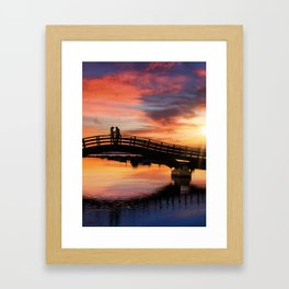 Couple enjoying the romantic sunset on the Lefkas town bridge in Greece Framed Art Print