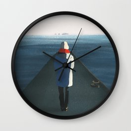 Cold girl in front of the sea Wall Clock