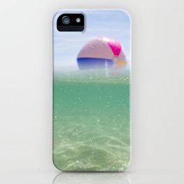 above and below clear blue sea with beach ball iPhone Case
