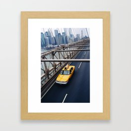 New York Cab with Twin Towers in background over Brooklyn Bridge Framed Art Print