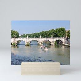 Tourist boat passes under Ponte Sant'Angelo in Rome - Italy Mini Art Print