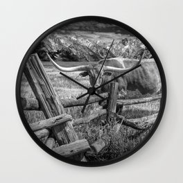 Texas Longhorn Steer by an Old Wooden Fence in Black and White Wall Clock