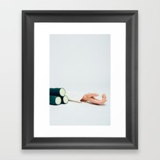 Hand next to cucumbers Framed Art Print