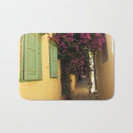 narrow cute street in greece Bath Mat