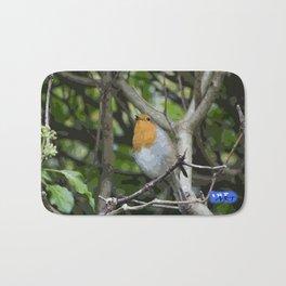 Robin on a branch Bath Mat