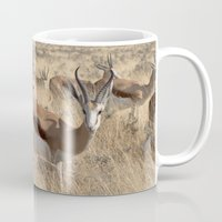 greg guillemin Mugs featuring Springbok herd - Greg Katz by Artlala for MSF Doctors Without Borders