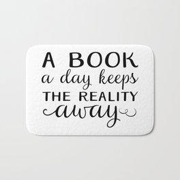 Book a day keeps reality away - black Bath Mat