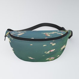 Edge of Pond With Scattered Flower Petals Fanny Pack