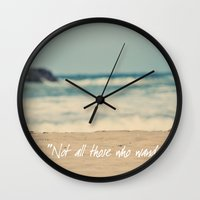 not all those who wander are lost Wall Clocks featuring Not all those who wander are lost. by Angela