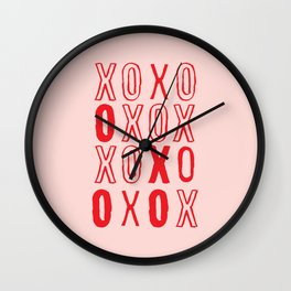 XOXO hugs and kisses in pink and red Wall Clock