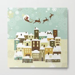 Santa flying in his sleigh over a village Metal Print