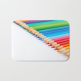Color pencils in diagonal pattern on white background Bath Mat