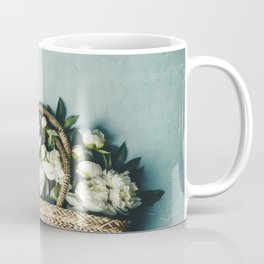 Beautiful peony flowers in straw bag over blue rustic background Coffee Mug