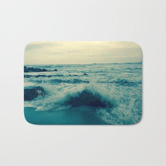Waves crashing against rocks   Beach Bath Mat