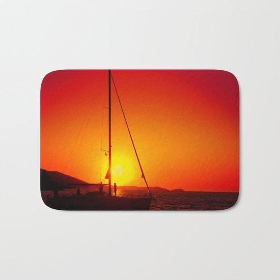 A sailboat at sunset Bath Mat