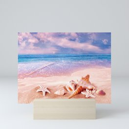 Seashells on the beach Mini Art Print