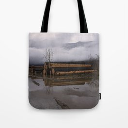 Timber Logs With A Foggy Mountain View Tote Bag