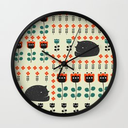 Cats napping between flowers Wall Clock