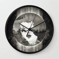 planet Wall Clocks featuring Planet by Ozghoul