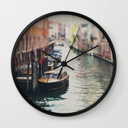 A boat moored on a Venice canal ... Wall Clock