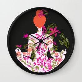 flower meditation on black background Wall Clock