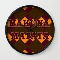 hakuna Wall Clocks featuring Hakuna Matata by ParadiseApparel