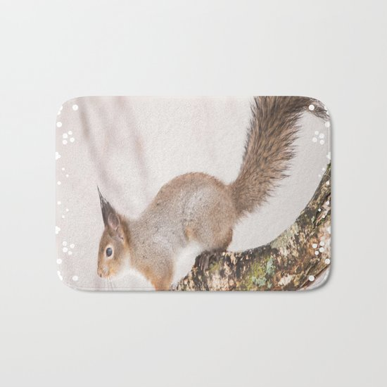 Little squirrel jumping on the branch Bath Mat