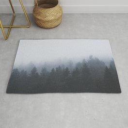 Mysterious forest in the fog Rug