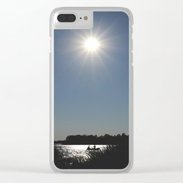 Silhouettes of two people on a rubber boat in a sunny reflection Clear iPhone Case