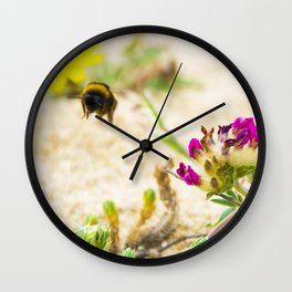the flight of bumble bee on the bunes Wall Clock