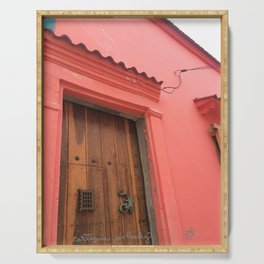 Cartagena is Peachy, Colombia, South America. Coral Pink Building with Ornate Lizard design Serving Tray