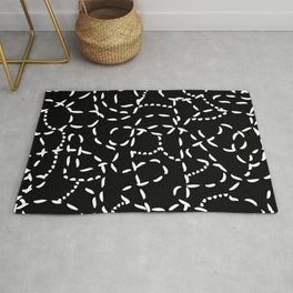 White Lines on Black Rug