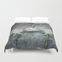 three of the possessed Duvet Covers featuring Three by Maria Heyens