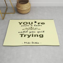 You're never a loser until you quit trying.- Mike Ditka Rug