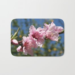 Close Up Peach Tree Blossom Against Blue Sky Bath Mat