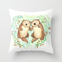 otters Throw Pillows featuring Otters Holding Hands by Georgia Dunn