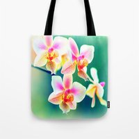 orchid Tote Bags featuring orchid by haroulita