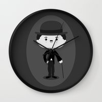 charlie chaplin Wall Clocks featuring Charlie Chaplin by Sombras Blancas Art & Design