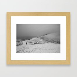 Walker on snow covered peaks. Mam Tor above Castleton, Peak District, Derbyshire, UK Framed Art Print