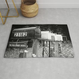 Black and white row of old road country us mailboxes Rug