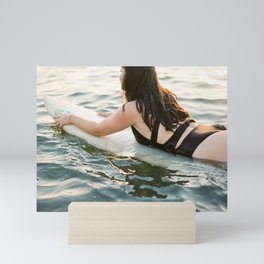 Surfer girl II | Wanderlust photography of a woman on het surfboard | Coastal wall art. Mini Art Print