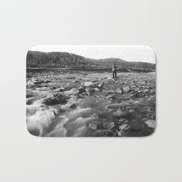 Man with rifle stands in mountain stream as it floods, east of Palmdale, California, ca.1920 Bath Mat