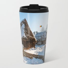Sun warming up a traditional Romanian homestead covered in heavy snow Travel Mug