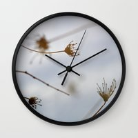 "wind Wall Clocks featuring ""Wind"" by Guido Montañés"