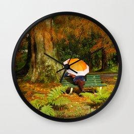Woman sitting with umbrella Wall Clock