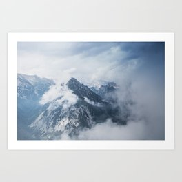 Misty mountain tops in the Alps Art Print