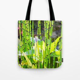 A view from the garden seat to the pond plants. Tote Bag