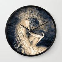 introvert Wall Clocks featuring introvert. by Viviana Gonzalez